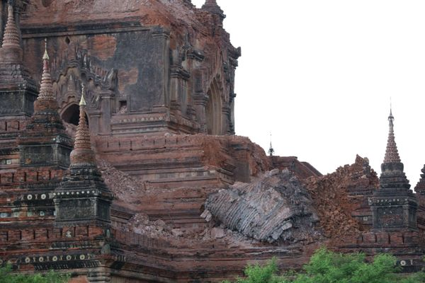 Collapsed walls surround an ancient pagoda after a 6.8 magnitude earthquake hit Bagan on August 24, 2016.