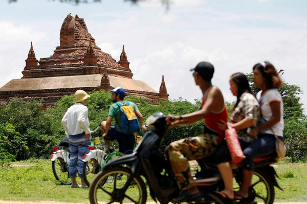 Tourists look at a damaged pagoda after an earthquake in Bagan, Myanmar August 25, 2016.