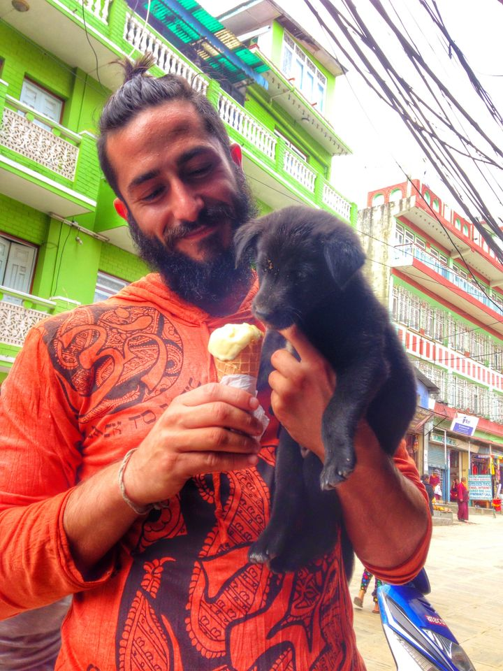 Feeding puppies in Nepal, overly bearded; 2014