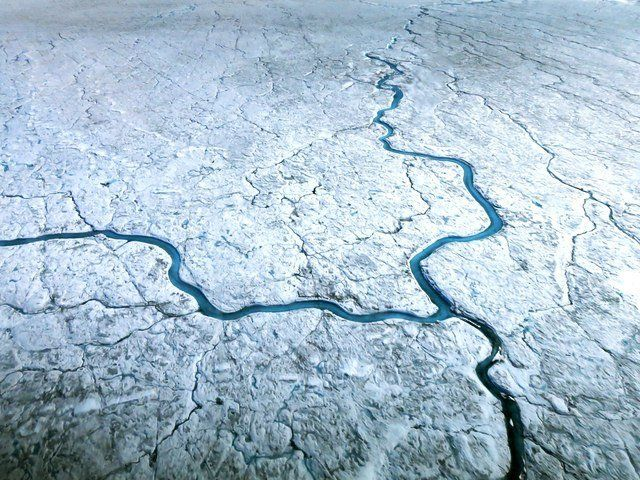 Greenland loses ice to the sea mainly through two processes the shedding of icebergs from glaciers that run into the sea and