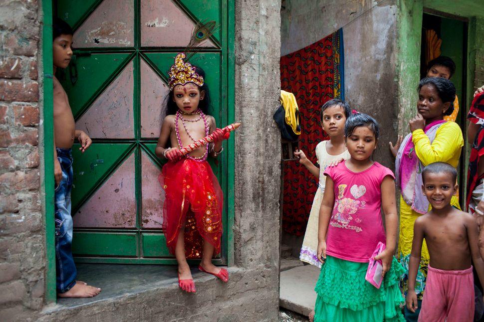 A boy dressed like Lord Sri Krishna takes part in the celebration of Janmashtami.