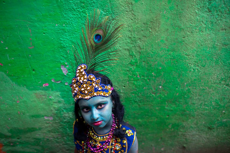 Aboy dressed like Lord Sri Krishna celebratesJanmashtami.