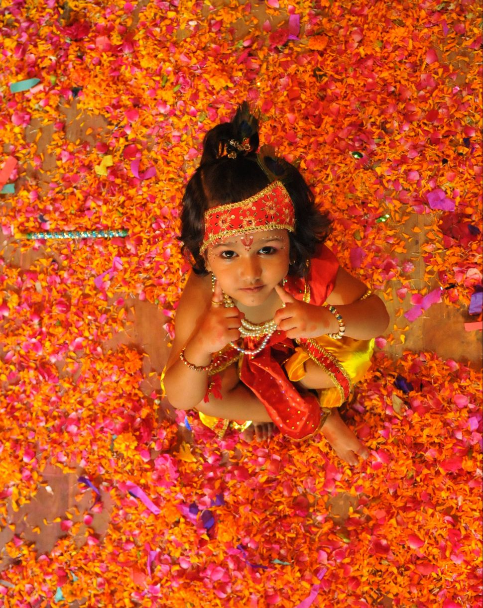 a child dressed as lord krishna during the janmashtami celebrations on august 24 2016 in