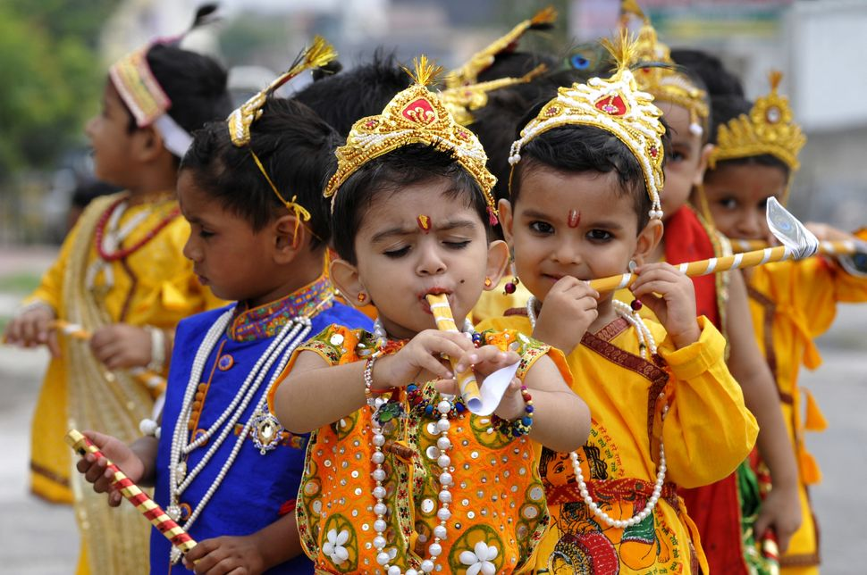 Students at play school dressed like Lord Krishna at a program ahead of Janmashtami on August 24, 2016 in Noida, India.
