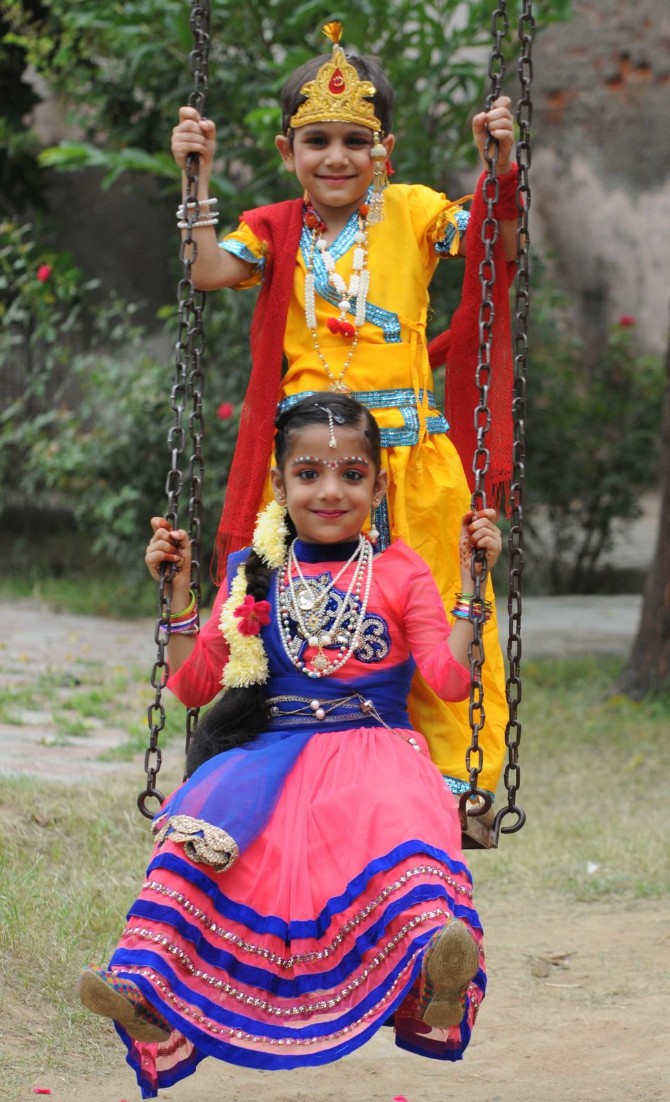 Children dressed up as Lord Krishna and Radha on the eve of the Janmashtami on August 24, 2016 in Patiala, India.