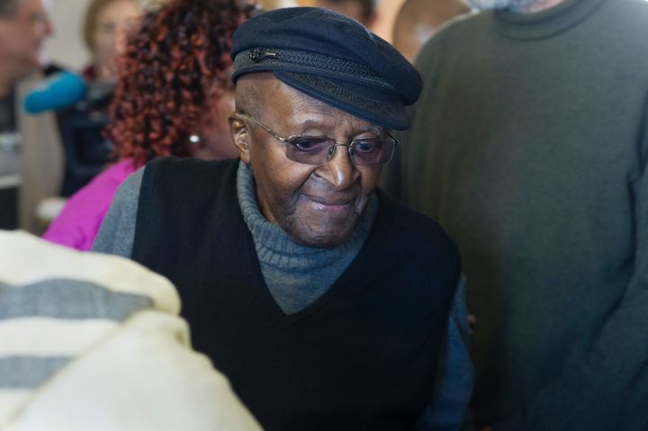 South African anti-apartheid activist and Nobel Peace Laureate Archbishop Desmond Tutu arrives to cast his vote in the South