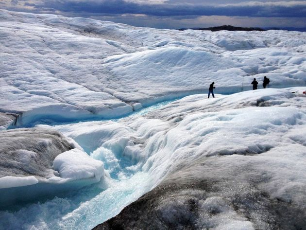 A team from Rutgers University and the University of Georgia measures meltwater runoff from the ice sheet...