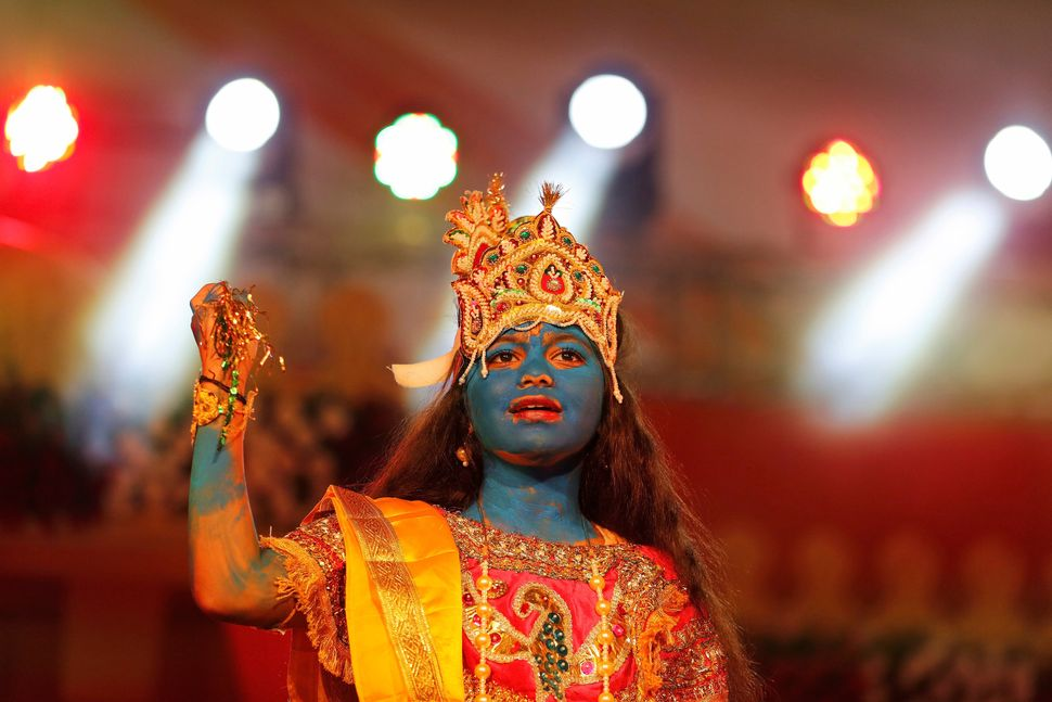 A girl dressed up as Hindu Lord Krishna performs during Janmashtami festival celebrations in Ahmedabad, India on August 25, 2