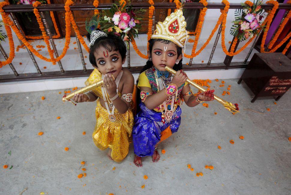 Children dressed up as Hindu Lord Krishna pose during Janmashtami festival celebrations in Agartala, India on August 24, 2016