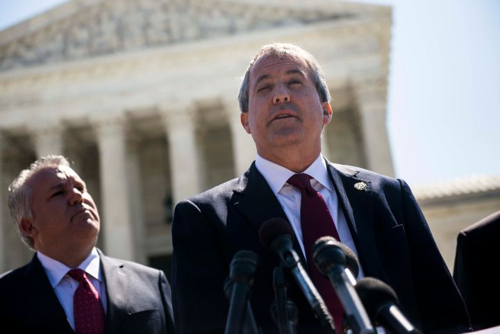 Texas Attorney General Ken Paxton (right) has filed 13 lawsuits against the Obama administration.