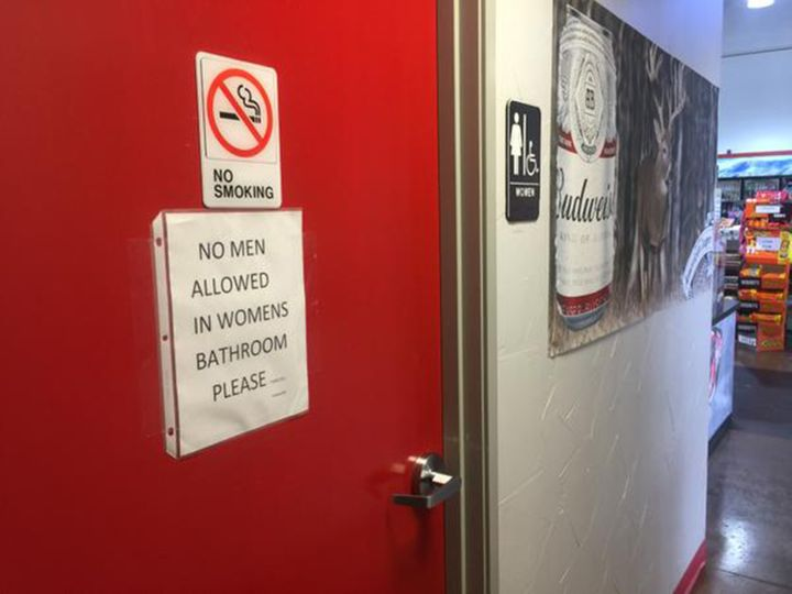 A sign on the women's bathroom door at the Texaco Station and BBQ on the Brazos restaurant seemsto make clear the owner
