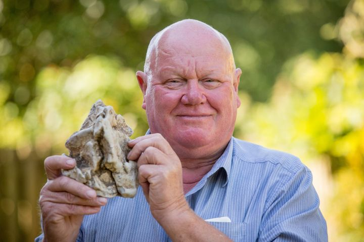 Alan Derrick 67 holds up a piece of whale vomit he found on a beach in Somerset UK. Turns out it could be worth $85,000.
