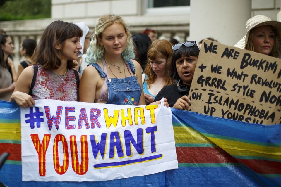 Protesters from different societies stage a demonstration named 'Wear What You Want' themed as a beach party style, outside t