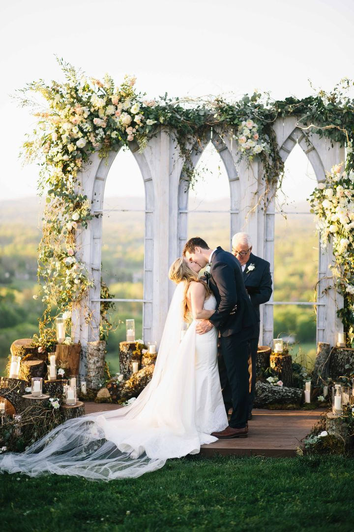 "They said their ""I dos"" at the top of a hill with gorgeous <a href=""http://www.stylemepretty.com/2016/08/21/olympic-gold-medalist-shawn-johnsons-wedding/"" target=""_blank"">360-degree views</a>.&nbsp;"