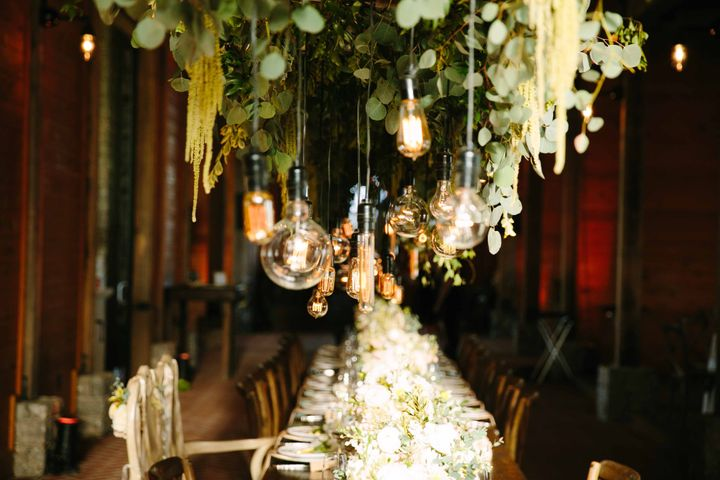 Exposed bulbs hung over the head table at the reception.