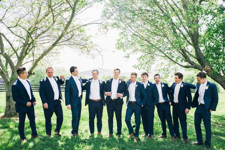 The groomand his nine groomsmen looked dapper in their attire.