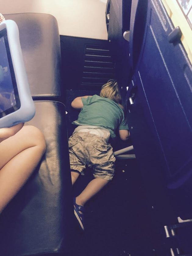 Exhausted Toddler Fell Asleep In Ryanair Plane Aisle After Two Hours 'Helping' Flight
