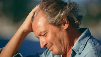 Profile of worried man outdoors