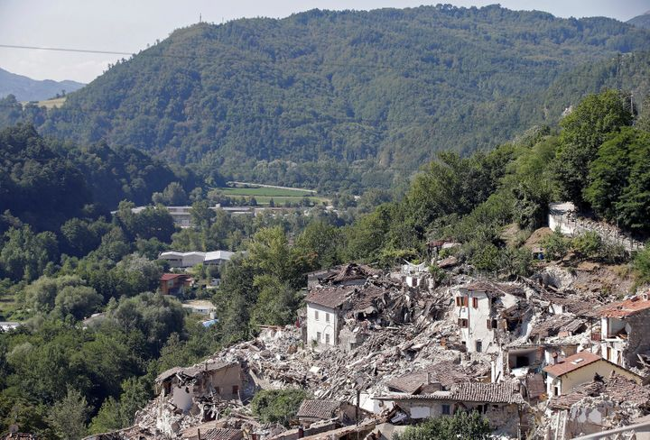 Collapsed houses are seen following an earthquake in Pescara del Tronto, central Italy, August 26, 2016.
