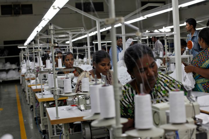 Employees sew clothes at the Estee garment factory in Tirupur, in the southern Indian state of Tamil Nadu June 19, 2013.