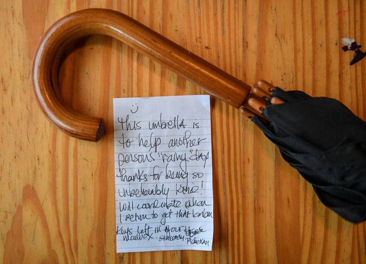 An umbrella and a noteleft by the last woman who stayed at Arafa's apartment.