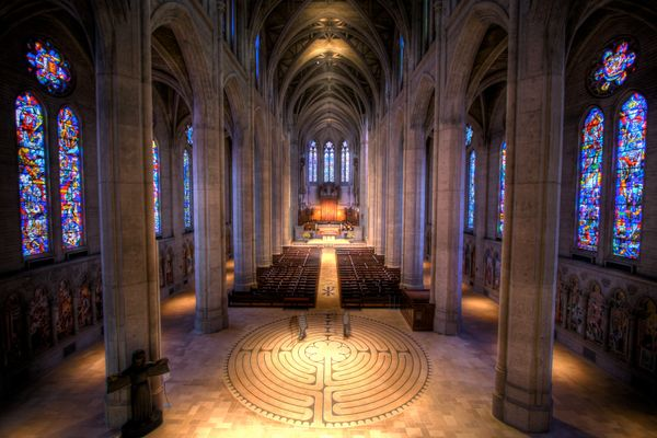 "A labyrinth between enormous pillars and stained glass windows defines the interior of Grace Cathedral. It is a <a href=""http"