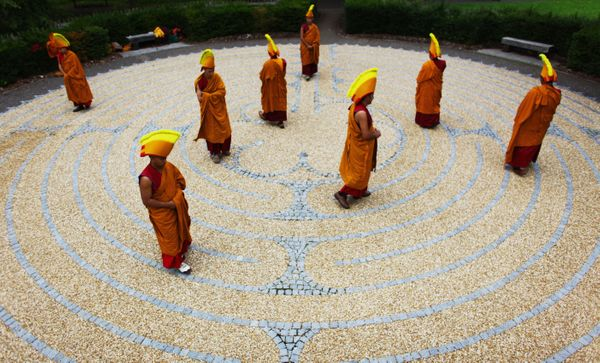 Monks from the Tashi Lhumpo Monastary walk the Edinburgh Labyrinth at the University of Edinburgh on August 25, 2010 in Edinb