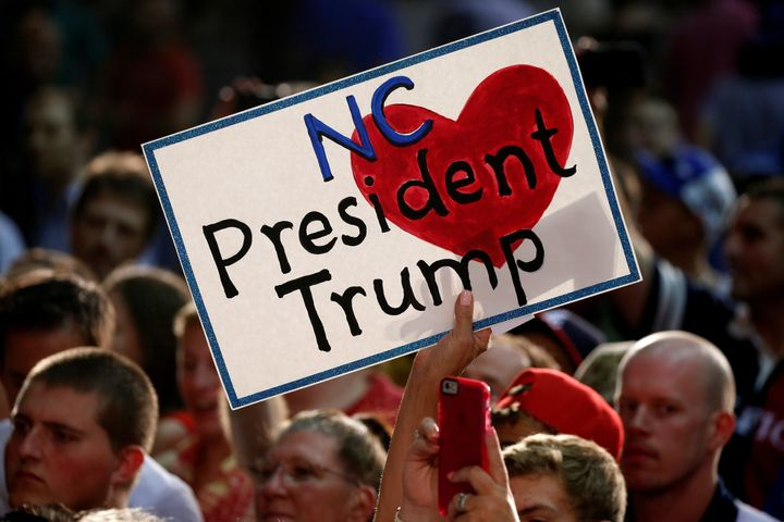A supporter holds a sign as Republican presidential nominee Donald Trump speaks at a campaign event in Winston-Salem, North C