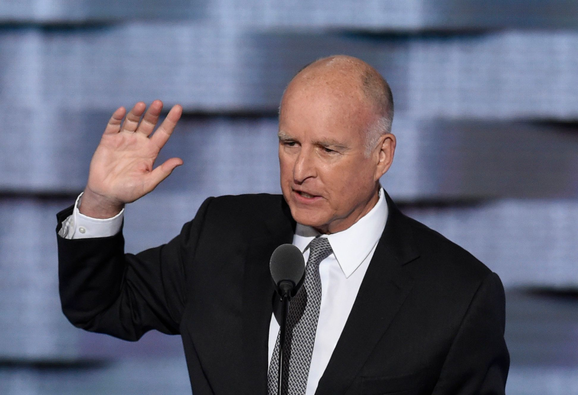 California Governor Jerry Brown addresses Day Three of the Democratic National Convention at the Wells Fargo Center in Philadelphia, Pennsylvania, July 27, 2016. / AFP / SAUL LOEB        (Photo credit should read SAUL LOEB/AFP/Getty Images)