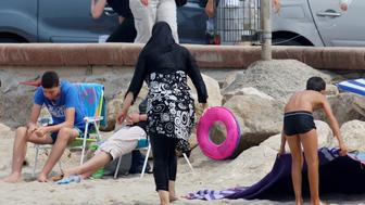 A Muslim woman wears a burkini, a swimsuit that leaves only the face, hands and feet exposed, on a beach in Marseille, France, August 17, 2016.    REUTERS/Stringer/File Photo