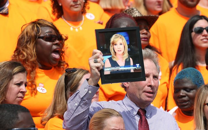 Andy Parker, father of murdered television reporter Alison Parker, holds up her picture during a rally with gun violence surv