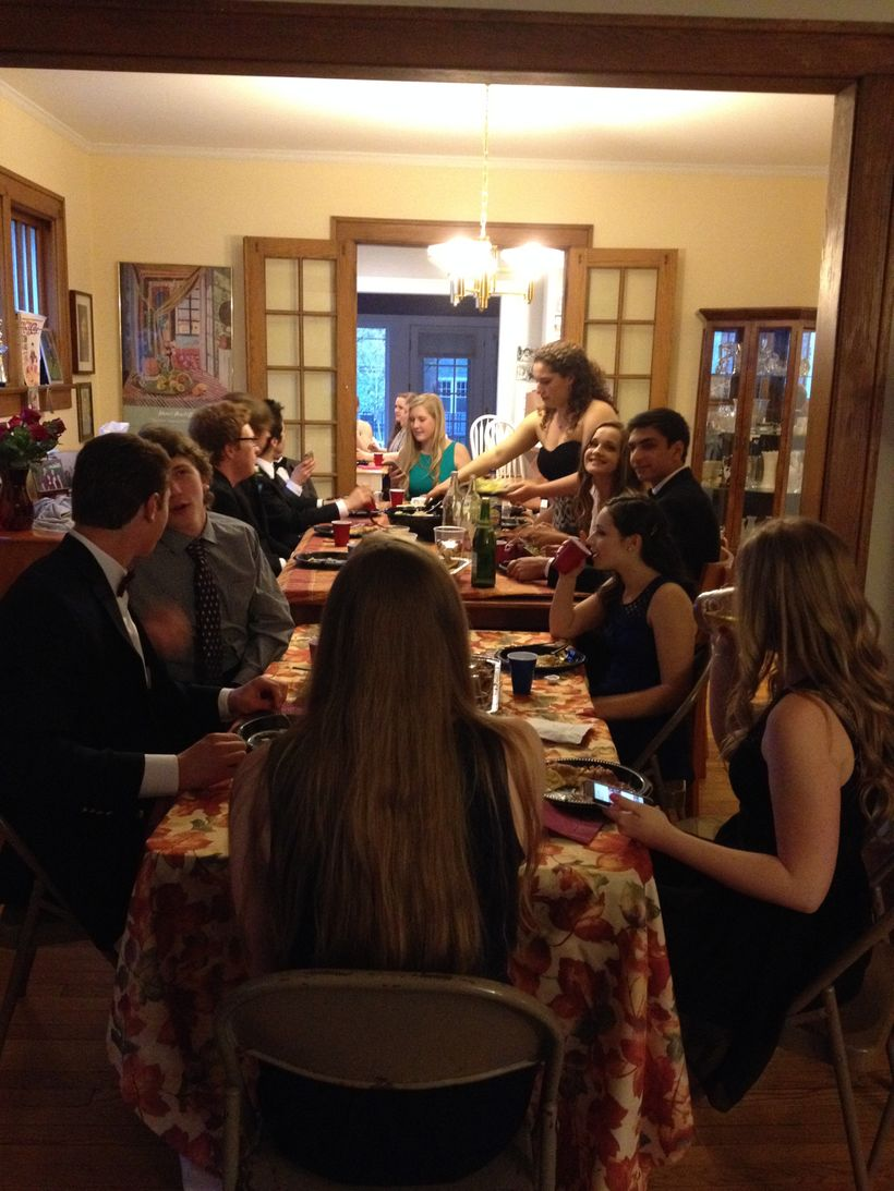 My daughter, and a dozen of her friends, at a dinner held (where else?) at our house before the high school prom in 2015.