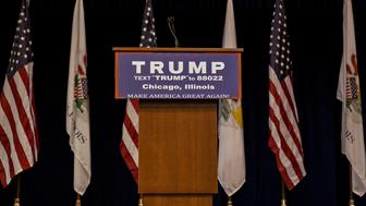 An empty podium stands on stage during a canceled campaign event with Donald Trump, president and chief executive of Trump Organization Inc. and 2016 Republican presidential candidate, was announced at the University of Illinois at Chicago Pavilion in Chicago, Illinois, U.S., on Friday, March 11, 2016. Trump canceled a Friday evening rally in Chicago after his campaign met with law enforcement and concluded it wasn't safe to proceed amid extensive protests in the heavily Democratic city. Photographer: Daniel Acker/Bloomberg via Getty Images
