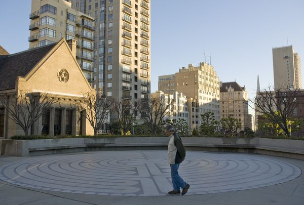 A man walks through the outdoor labyrinthat Grace Cathedral.