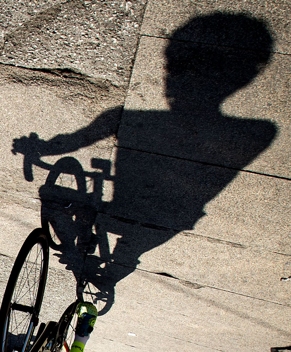 The shadow of Tinkoff's Spanish cyclist Alberto Contador is projected on the ground before the start of the fourth stage of t