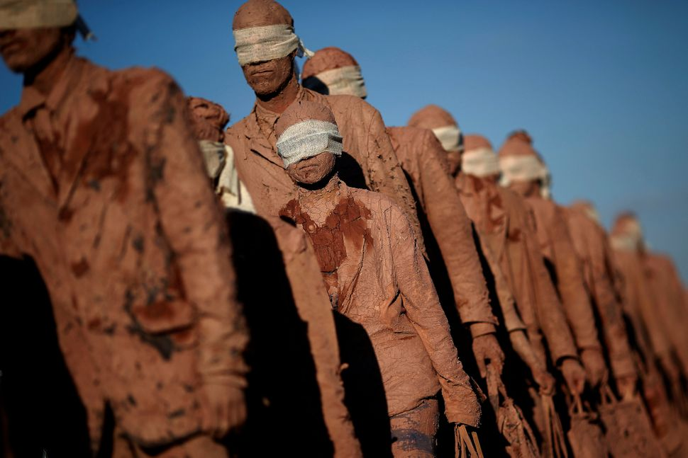 """Artists from the Deviation Collective group take part in the performance called """"Cegos,"""" or """"Blind,"""" in front of the Planalto"""