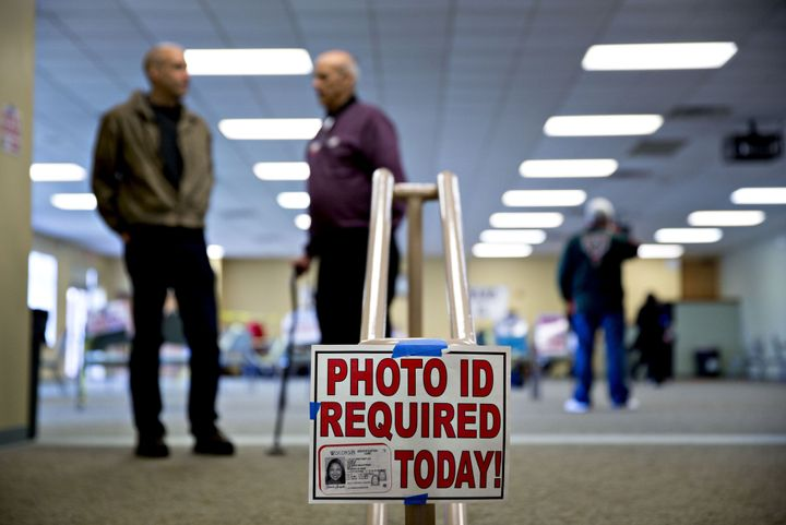 Wisconsin's voter identification law, which was enforced during the primaries, will stay on the books. Sort of.