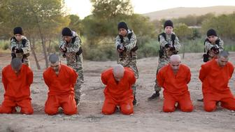 Child ISIS fighters shoot prisoners to death