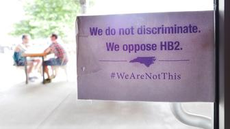 DURHAM, NC - MAY 10:  The 'We Are Not This' slogan is posted at the entrances to Bull McCabes Irish Pub on May 10, 2016 in Durham, North Carolina.  Debate over transgender bathroom access spreads nationwide as the U.S. Department of Justice countersues North Carolina Governor Pat McCrory from enforcing the provisions of House Bill 2 (HB2) that dictate what bathrooms transgender individuals can use.  (Photo by Sara D. Davis/Getty Images)