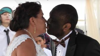 Larry The Wolf Boy kisses his bride Alicia Martinez