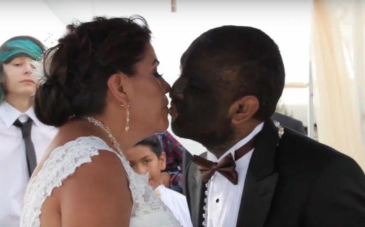 Larry Gomez kisseshis bride, Alicia Martinez.