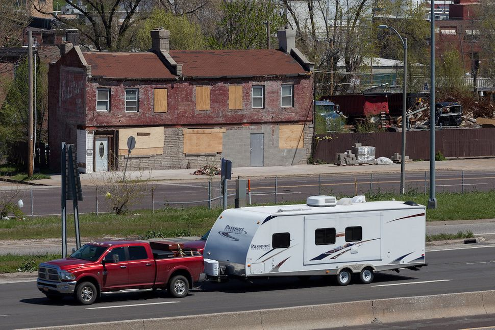 "North Riverfront neighborhood of St. Louis. ""Tourists hauling mobile homes in a variety of makes and models pass through"