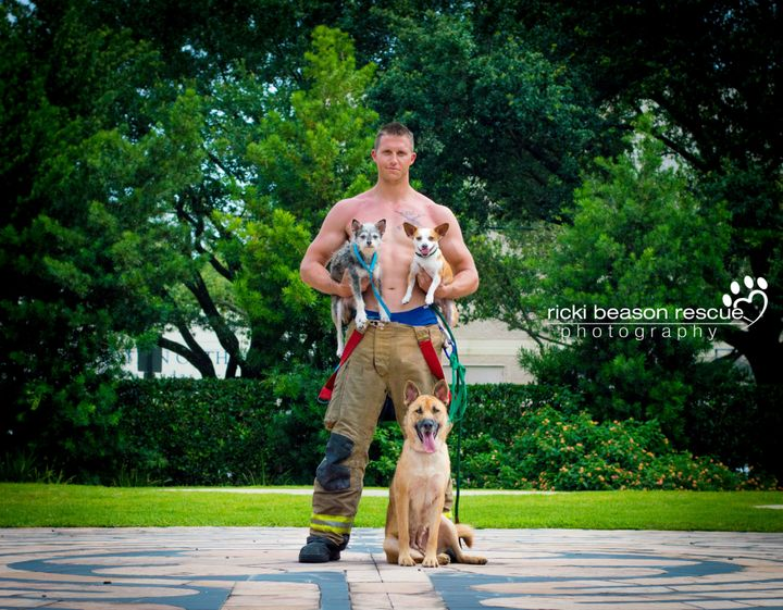 Dustin, Mr. February, posing with Luke and Ackbark from Forgotten Dogs of the 5th Ward.