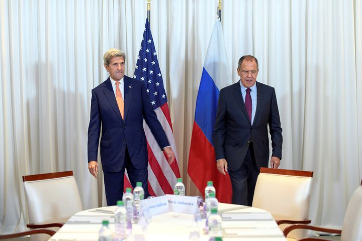 U.S. Secretary of State John Kerry (L) and Russian Foreign Minister Sergei Lavrov (R) before a bilateral meeting focused on t