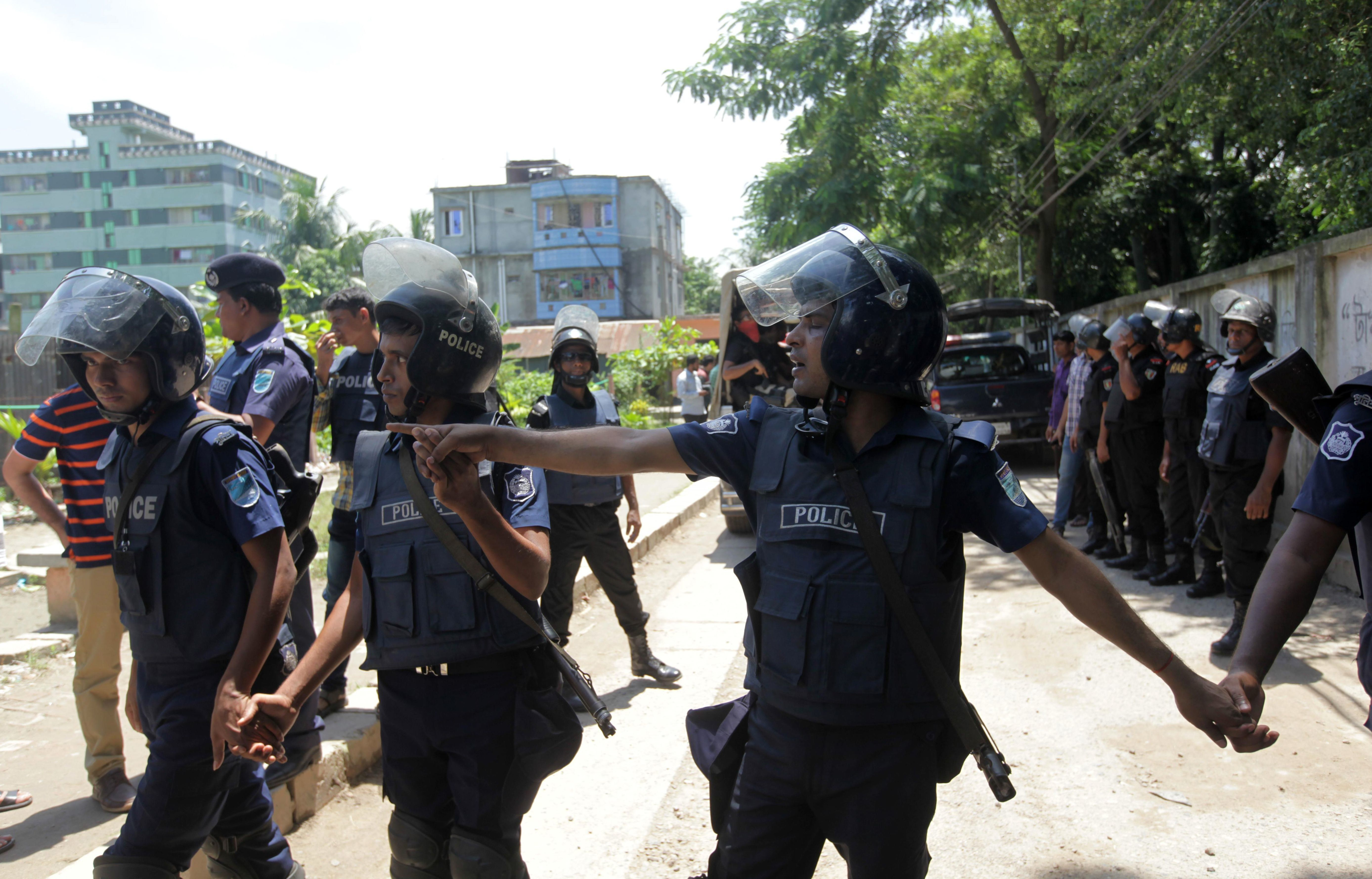 Bangladesh police stand guard at the scene of an operation to storm a militant hideout in Narayanganj, some 25 kms south of Dhaka on August 27, 2016. Bangladesh police stormed a militant hideout outside Dhaka August 27, shooting dead three Islamist extremists, including the suspected mastermind of a horrific attack on a cafe that killed 22 mostly foreign hostages last month. The three bodies were retrieved after police staged an hour-long gun battle with extremists in Narayanganj, a city 25 kilometres (16 miles) south of Dhaka, officers said.  / AFP / STR        (Photo credit should read STR/AFP/Getty Images)