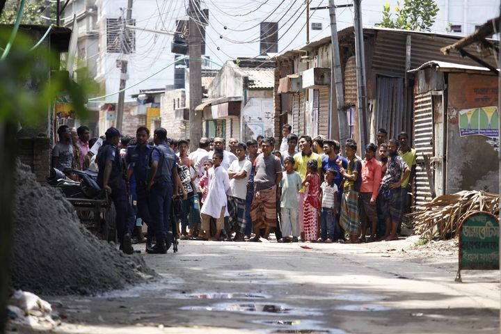 Bangladesh police attend the scene of an operation where they stormed a militant hideout in Narayanganj, around 25 kms south