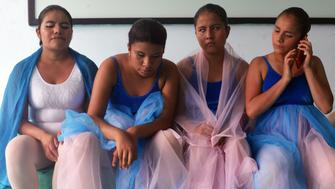 From left to right Susy 22 Itary 15 Rosaura 17 and Pati 13 wait to be called out for their first dance in Chiapas southern Mexico