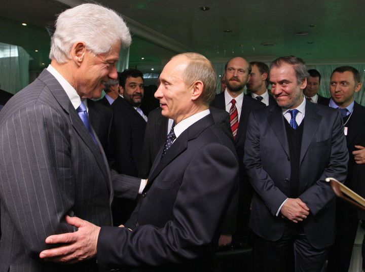 Former President Bill Clinton greeting Russian President Vladimir Putin at the World Economic Forum in Davos, Switzerland in