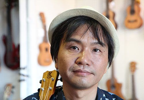 <i>Photo by Nancy A. Ruhling</i><br><strong>Masafumi plays guitar, ukulele and drums.</strong>