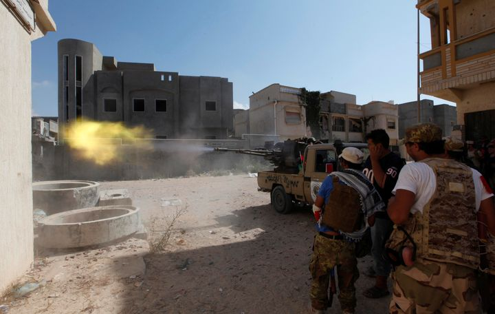 embers of Libyan forces allied with the UN-backed government fire a weapon towards Islamic State militants in neighbourhood N